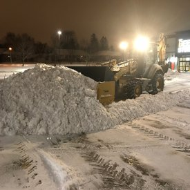 Snow removal clearing at night