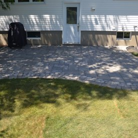 How to Install a Permeable Interlock Patio Next to a Foundation
