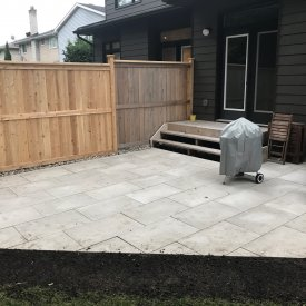 Patio In Backyard with Fence